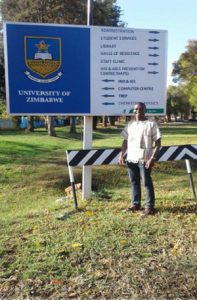 GEMx Exchange Student in front of university sign