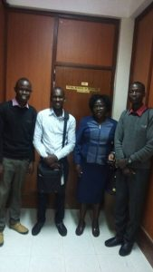 Student poses with the admin staff at Kenyatta University