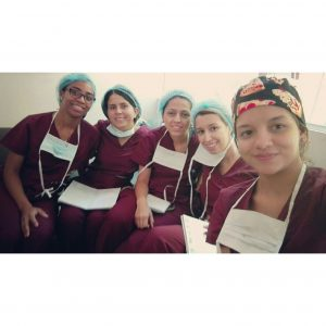 group of five women in hospital scrubs