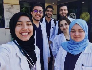 smiling students outside of hospital