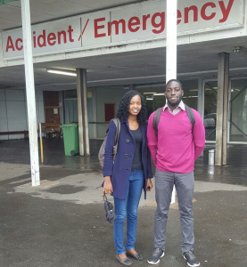 Nancy and Tendwa standing in front of Accident/Emergency Department