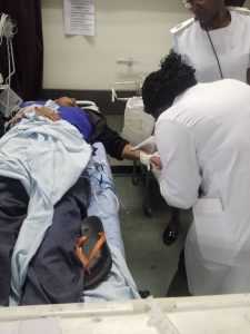Students taking care of patient
