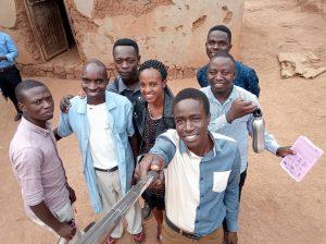 Students huddled around community health worker